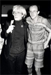 Andy Warhol and Keith Haring during Andy Warhol and Keith Haring at the Palladium - July 26, 1985 at The Palladium in New York City, New York, United States. (Photo by Ron Galella, Ltd./WireImage)