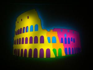 Marco Lodola, Colosseo, pezzo unico, Scultura in perspex luminosa, 150x106 cm. Disponibile alla Galleria Deodato Arte.