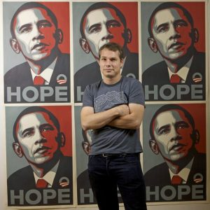 FILE - In this Jan. 12, 2009 file photo, Los Angeles street artist Shepard Fairey poses for a picture with his Barack Obama Hope artwork in the Echo Park area of Los Angeles. The Associated Press and Fairey announced Wednesday, Jan. 12, 2011, that they have agreed to settle their copyright infringement claims against each other and will work together again in projects that use the news agency's pictures. (AP Photo/Damian Dovarganes, File)